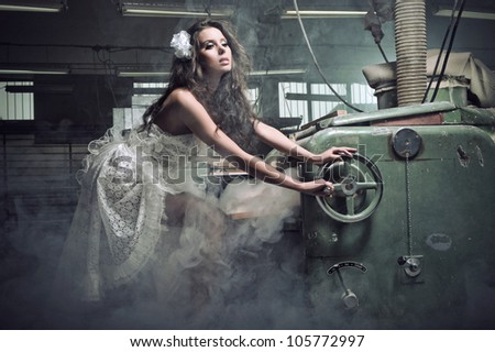 Portrait of an amazing woman, who enchanted board cuts - stock photo
