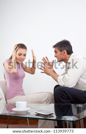Portrait of an angry couple arguing. - stock photo