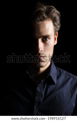 Portrait of an angry man expression isolated on a black background         - stock photo