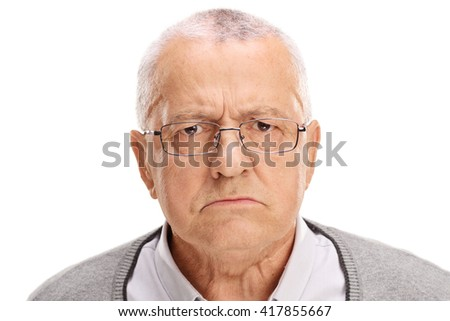 Portrait of an angry senior frowning and looking at the camera isolated on white background - stock photo