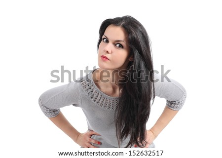 Portrait of an angry woman looking at camera isolated on a white background - stock photo