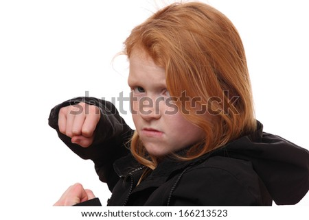Portrait of an angry young girl on white background - stock photo