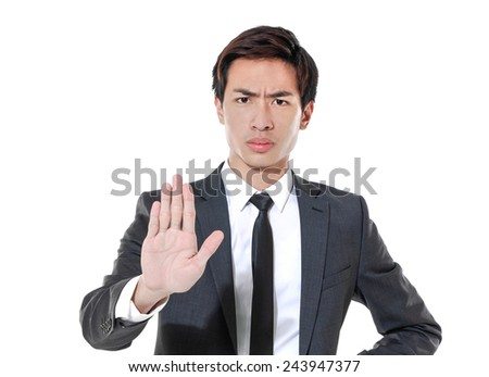 Portrait of an angry young male entrepreneur showing stop sign  - stock photo