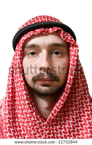 Portrait of an arabian young man in traditional headscarf - shemagh. - stock photo