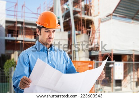 Portrait of an architect at work in a construction site - stock photo