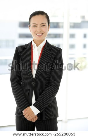 Portrait of an Asian Businesswoman with hands folded - stock photo