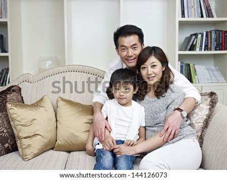 portrait of an asian family. - stock photo