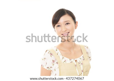 Portrait of an Asian housewife - stock photo