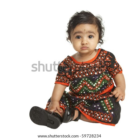 Portrait of an Asian Indian Baby Girl in Traditional Attire  on White - stock photo