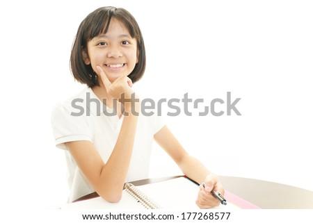 Portrait of an Asian schoolgirl - stock photo