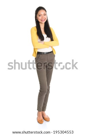 Portrait of an Asian woman smiling, full length standing isolated on white background. - stock photo