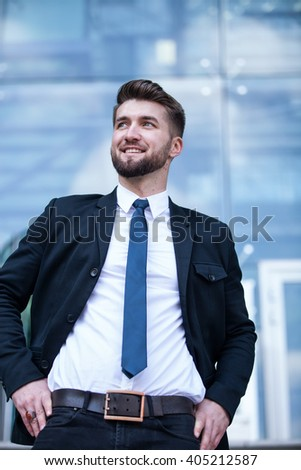 Portrait of an attractive and successful business man - stock photo
