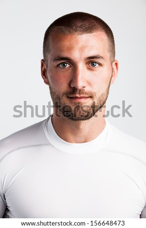 Portrait of an attractive athlete in sport dress - stock photo