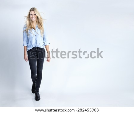 Portrait of an attractive blonde woman in a studio with a white background - stock photo