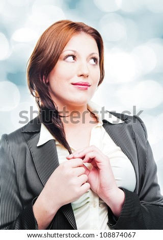 Portrait of an attractive business woman dreaming - stock photo