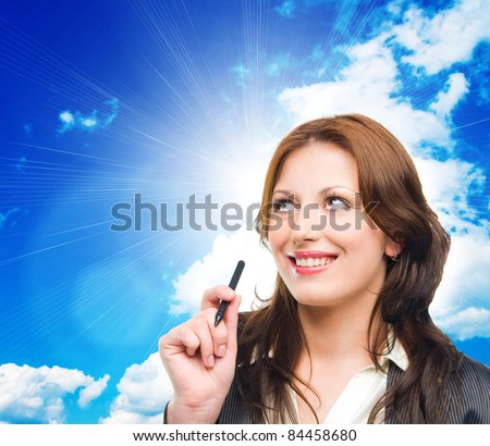Portrait of an attractive business woman dreaming on blue sky - stock photo