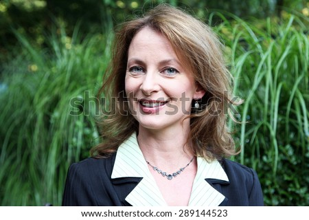 Portrait of an attractive business woman outdoors - stock photo