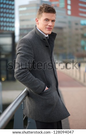 Portrait of an attractive businessman standing outside - stock photo