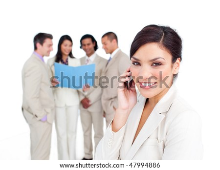 Portrait of an attractive businesswoman on phone with her team on the background - stock photo