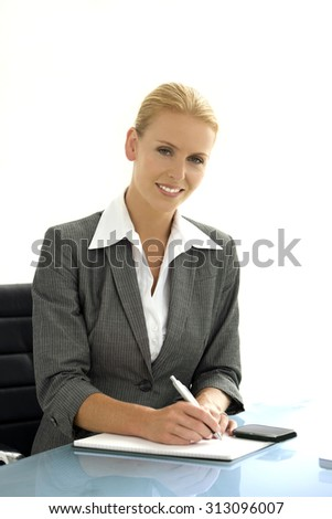Portrait of an attractive female manager sitting at a desk - stock photo