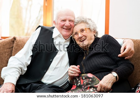 Portrait of an attractive happy senior couple posing close together - stock photo
