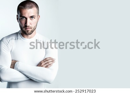 Portrait of an attractive man in sports dress - stock photo