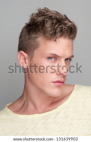 Portrait of an attractive man looking at camera - stock photo