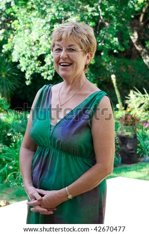 Portrait of an attractive mature woman in her 50s. - stock photo