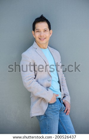 Portrait of an attractive middle aged asian man smiling - stock photo