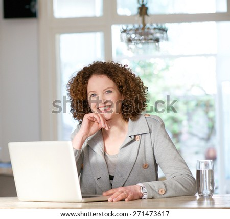 Portrait of an attractive older woman using laptop at home - stock photo