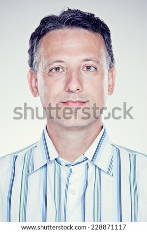 Portrait of an attractive senior man happily smiling at the camera  - stock photo