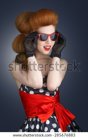 Portrait of an attractive smiling young woman in sunglasses. Retro style. - stock photo
