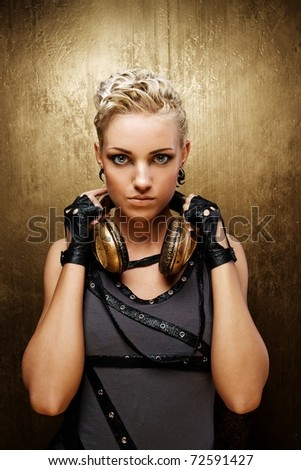 Portrait of an attractive steam punk girl with headphones - stock photo
