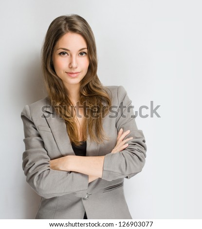 Portrait of an attractive stylish young brunette woman. - stock photo