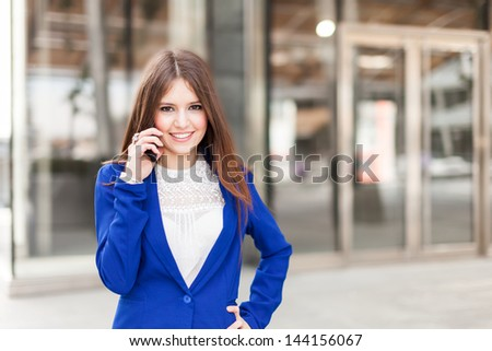 Portrait of an attractive woman talking on the phone - stock photo