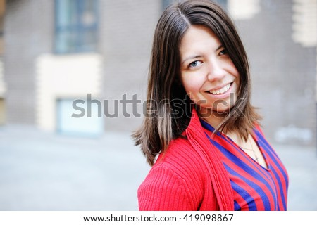 Portrait of an attractive woman walking and sightseeing in the city - stock photo