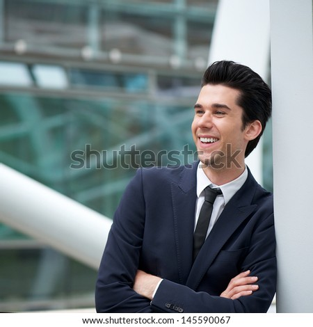 Portrait of an attractive young businessman smiling outdoors - stock photo