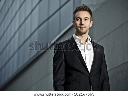 Portrait of an attractive young man outside - stock photo