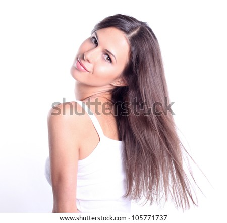 Portrait of an attractive young woman against white background - stock photo