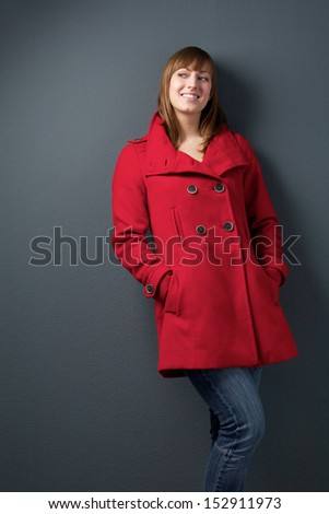 Portrait of an attractive young woman in red jacket - stock photo