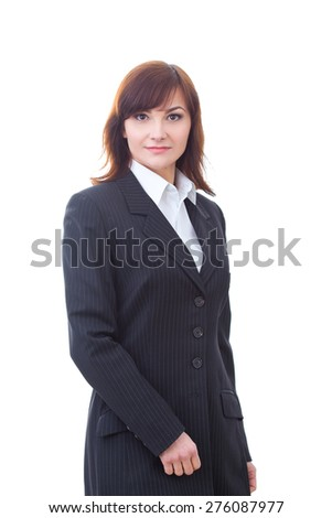 Portrait of an confident businesswoman in suit standing against isolated background.  - stock photo
