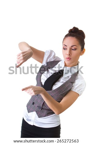 Portrait of an confident businesswoman pointing at. This photo has been produced with these professionals : make-up artist, hair dresser and stylist.  - stock photo