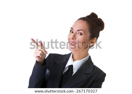Portrait of an confident businesswoman pointing at. This photo has been produced with these professionals : make-up artist, hair dresser and stylist. A professional retoucher gave it the final magic - stock photo