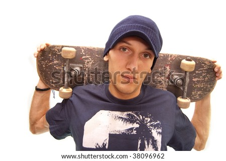 portrait of an cool skater with his board - stock photo
