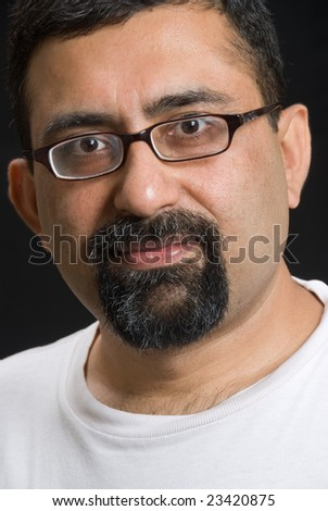 Portrait of an East Indian man wearing a white t-shirt - stock photo