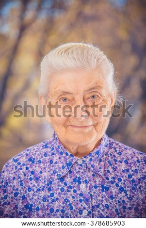 Portrait of an elderly grandmother - stock photo