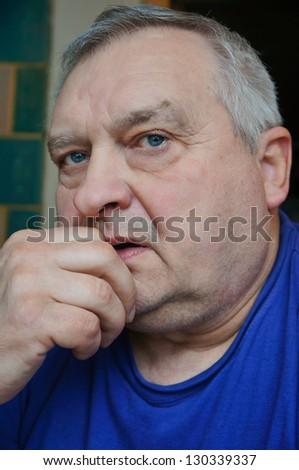 Portrait of an elderly man in a blue shirt - stock photo