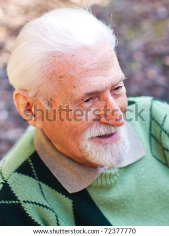 Portrait of an elderly man in the outdoors. - stock photo