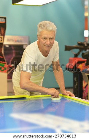 Portrait of an elderly man playing a board game - stock photo