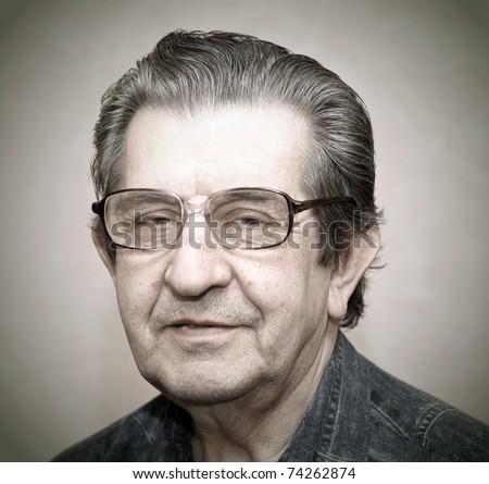 portrait of an elderly man smiling - stock photo